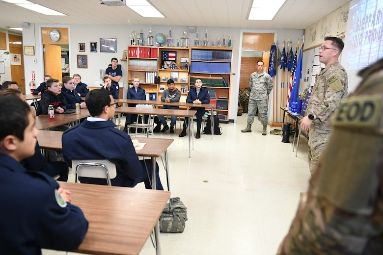 Senior Master Sgt. Eric Eberhard, 419th Explosive Ordnance Disposal Flight, explain the EOD career field in the Air Force. Technical Sgt. Andrew Mistkowski (back), 419th Fighter Wing recruiter, invited Hill Air Force Base EOD technicians to meet with Junior Reserve Officer Training Corps students at Clearfield High School in Clearfield, Utah, Dec. 12, 2018. (U.S. Air Force photo by Cynthia Griggs)