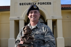 Staff Sgt. Kerry McGuire, 42nd Security Forces Squadron non - commission officer in charge of Physical and Electronic Security, won the Airman 1st Class Elizabeth N. Jacobson Award for Expeditionary Excellence on November 6th, 2018. The U.S. Air Force level award is given to Airmen for outstanding performance while deployed overseas. (U.S. Air Force Photo by Senior Airman Francisco Melendez – Espinosa