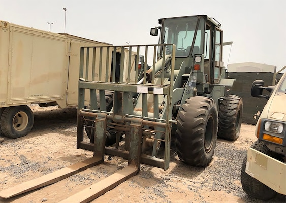 A John Deere forklift loader awaits sale at the DLA Disposition Services at Djibouti excess property yard onboard Camp Lemonnier. DLA recently completed its very first usable excess property sale on the continent of Africa.