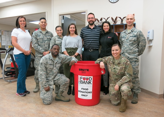 The 359th Medical Operations Squadron Physical Therapy Flight is leading the 359th Medical Group at Joint Base San Antonio-Randolph in food drives to assist the San Antonio Food Bank and the victims of Hurricane Michael. Helping out with the food drive on Dec. 10, 2018, are, front row from left, Staff Sgt. Gregory Jones, physical therapy technician, and Capt. Stephanie Chayrez, flight commander; and, back row from left, Jocelyn Lombard, physical therapist assistant; Airman 1st Class Albert Lapera, physical therapy technician; Senior Airman Monica Hoerner, family health technician; Carolyn Chavana, physical therapy intern from University of the Incarnate Word; Dr. Jason Wheeler, staff physical therapist; Jessica Bolin, Promotion Physical Therapy physician liaison; and Lt. Spencer Carrier, intern from Army-Baylor University Doctoral Program in physical therapy. The flight is partnering with Promotion Physical Therapy in San Antonio on the drive to benefit the San Antonio Food Bank.