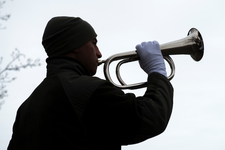 Senior Airman Naseem Eissa, 366th Fighter Wing base ceremonial guardsman, plays taps during funeral sequence training Dec. 7, 2018, at Mountain Home Air Force Base, Idaho. The U.S. Air Force Honor Guard held a ceremonial guardsman training course Dec. 3-12 to help the base honor guard maintain their skills during multiple member sequence training. (U.S. Air Force photo by Airman 1st Class JaNae Capuno)