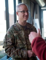 U.S. Air Force Chaplain (Capt.) Keith Beckwith, 133rd Chapel Corps, speaks to another service member at a Yellow Ribbon event in St. Paul, Minn., Nov., 11, 2018.