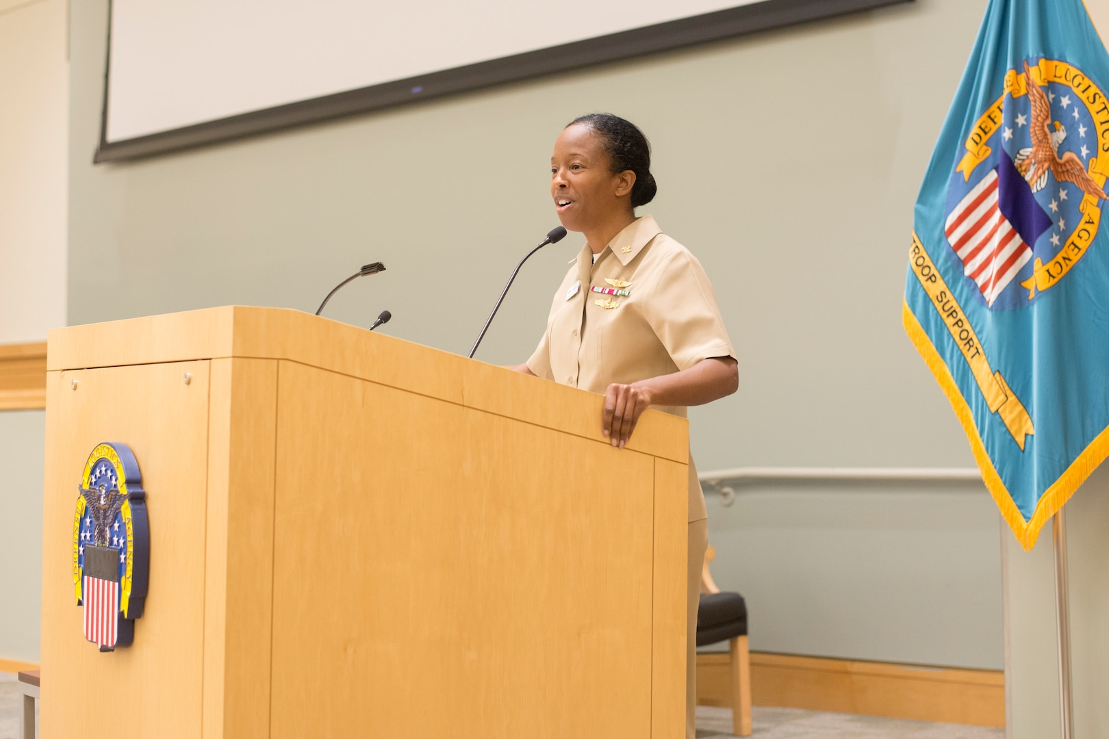 Navy Capt. Kerri Yarbrough, Naval Supply Systems Command Weapon Systems Support Aviation deputy commander, speaks to the audience during a National American Indian Heritage Month program at DLA Troop Support, Dec. 11, 2018 in Philadelphia.