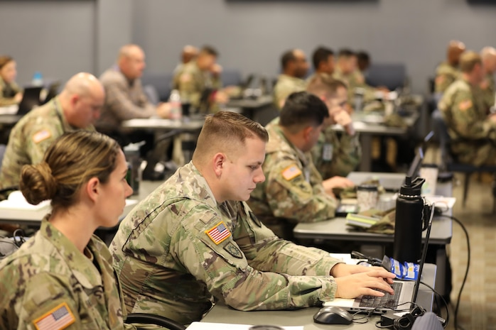 Army 2nd Lt. Kat Wilson and 1st Lt. DeWayne Cox 261st, Multi-Functional Medical Battalion, Fort Brag, N.C., participate in a Joint Operations Center Training Course at Fort Eustis, Dec., 11-13, 2018. The three-day course educated and prepared the Defense CBRN Response Force (DCRF) members of JTF-CS for a catastrophic Chemical, Biological, Radiological and Nuclear (CBRN) event. When directed, JTF-CS is ready to respond in 24 hours to provide command and control of 5,200 federal military forces located at more than 30 locations throughout the nation in support of civil authority response operations to save lives, prevent further injury and provide critical support to enable community recovery. (DoD photo by U.S. Air Force Tech. Sgt. Michael Campbell/ Released)