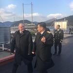 Rear Adm. Jimmy Pitts, Commander, Submarine Group 7, left, and Rear Adm. Jung Il Shik, Commander, Republic of Korea (ROK) Navy Submarine Force tour the ROK Naval Academy in Chinhae. Pitts was in South Korea for the biannual Submarine Warfare Committee Meeting with the ROK Navy Submarine Force.