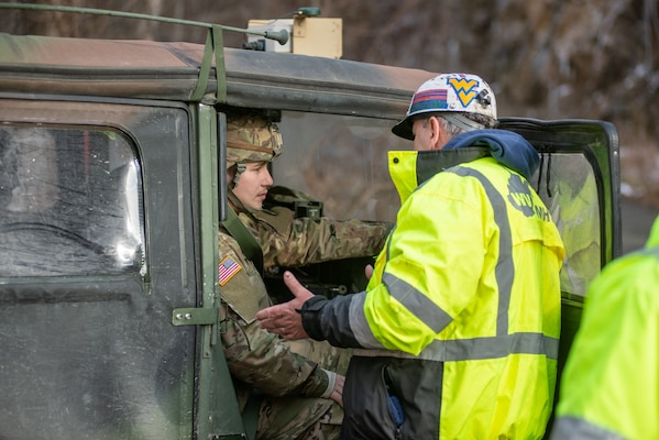 Soldiers from Charlie Company, 1st Squadron, 150th Cavalry Regiment, West Virginia National Guard, assist in convoy operations of mine rescue teams with the West Virginia Miners' Health, Safety, and Training agency at the Rock House Powellton coal mine in Whitesville, W.Va., Dec. 12, 2018. The WVNG is assisting rescue operations for three missing civilians who are believed to be lost in the shuttered mine site. (U.S. Army National Guard photo by Edwin Wriston)