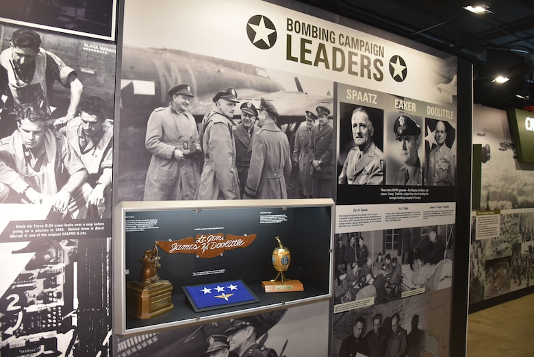 WWII Bombing Campaign Leaders Exhibit case which includes the Pickle Barrel Trophy, Lt. Gen. Doolittle's 3-star flag and name-pate, and the 1944 Collier Trophy on display at the National Museum of the U.S. Air Force. (U.S. Air Force photo)