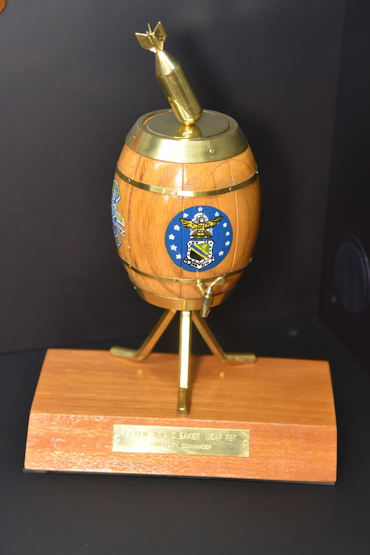 "Ira Eaker received this unique commemorative piece after the war in recognition of his leadership during the strategic bombing campaign.  It refers to the claimed ability of the Norden's bombsight to ""drop a bomb in a pickle barrel from 18,000 feet."""