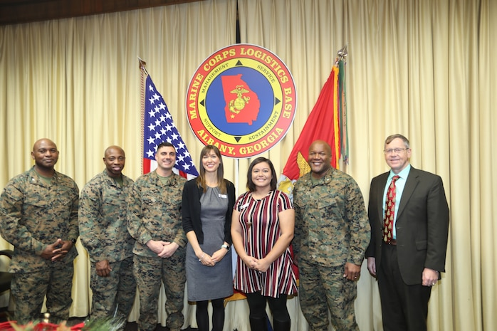 Two members of the Marine Corps Logistics Base Albany family were recognized Thursday with certificates for completing 100 hours of volunteer service with the local Navy-Marine Corps Relief Society.