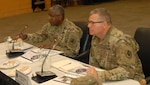 DLA Director Army Lt. Gen. Darrell K. Williams (left) and DLA Troop Support Commander Brig. Gen. Mark Simerly (right) listen as Troop Support senior leaders discuss key topics during a Dynamic Operating Plan review meeting at DLA Troop Support in Philadelphia Dec. 7, 2018.