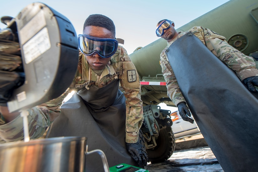 Army Sgt. Leroy Faulkner, a fuel supply specialist from Ft. Lee, Va., tests fuel to determine the amount of additives needed in order for it to reach military specification during a technical demonstration of the Expeditionary Mobile Fuel Additization Capability at the Charleston Defense Fuel Supply Point Dec. 6, 2018.