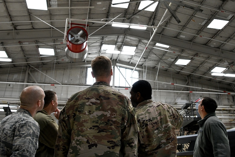 Col. Dee Jay Katzer, Air Combat Command chief of civil engineer division (center), observes newly installed LED lights Dec. 12, 2018, at Seymour Johnson Air Force Base, North Carolina.