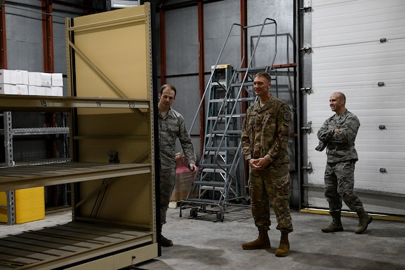 Col. Dee Jay Katzer, Air Combat Command chief of civil engineer division (center), examines a relocated shelving unit Dec. 12, 2018, at Seymour Johnson Air Force Base, North Carolina.