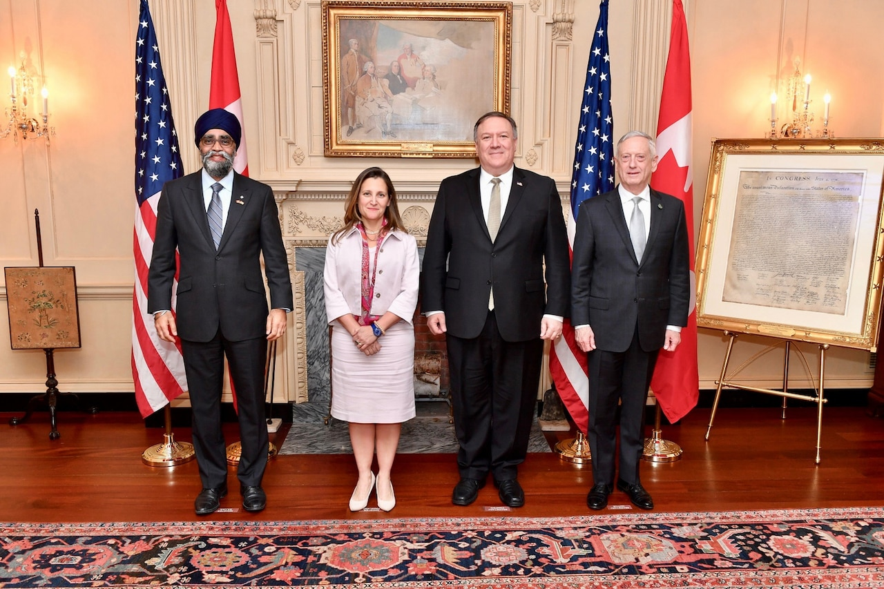 Canadian Minister of Defense Harjit Sajjan, Canadian Minister of Foreign Affairs Chrystia Freeland, Secretary of State Michael R. Pompeo and Defense Secretary James N. Mattis stand for a photo.