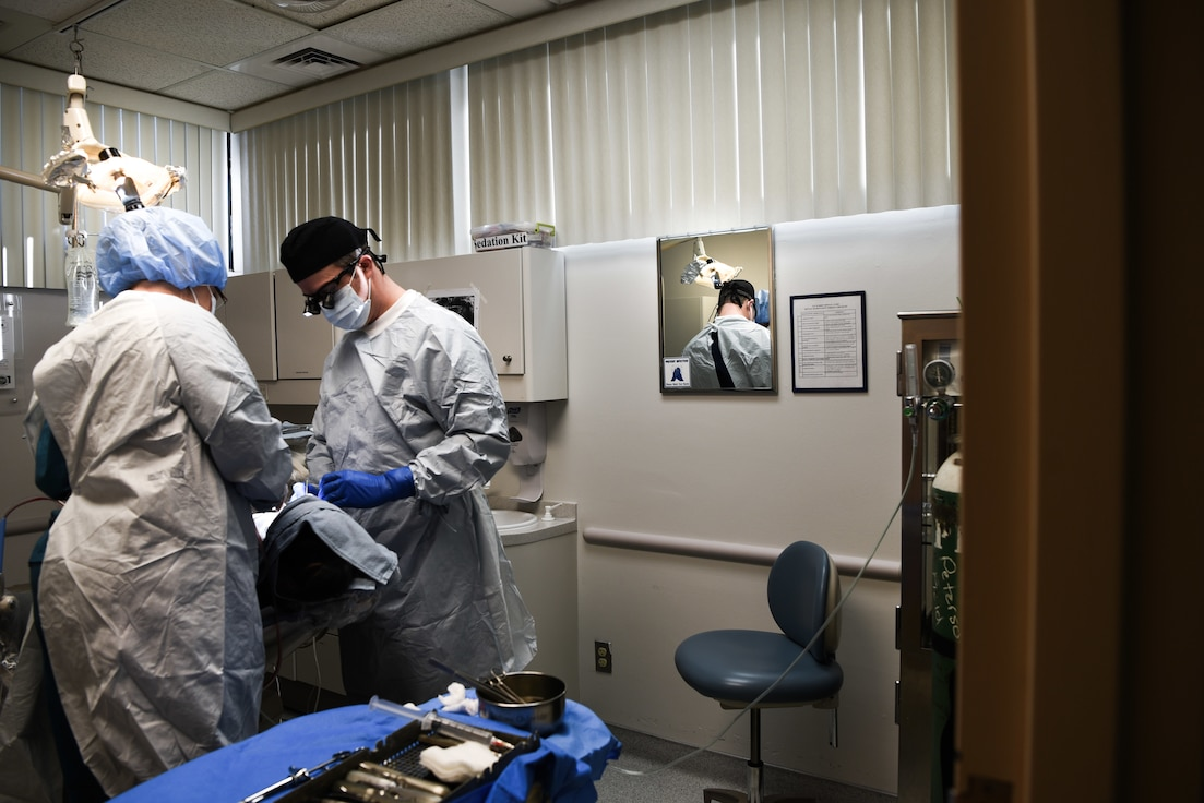 A 90th Medical Group dentist and technician preforms oral surgery on an Airman Jan. 16, 2018, on F.E. Warren Air Force Base, Wyo. The medical clinic recently won several awards from Air Force Global Strike Command, including Small Dental Clinic of the Year for the third time.