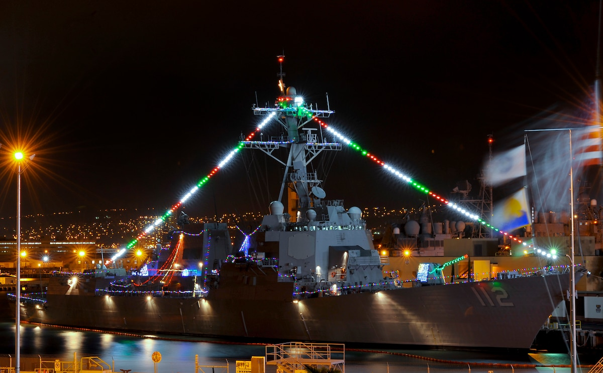 A ship decorated with Christmas lights