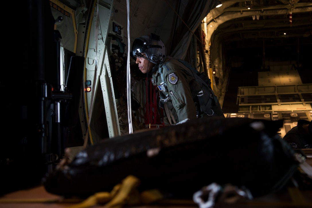 Gen. CQ Brown, Jr., Pacific Air Forces commander, flies on a C-130J, assigned to the 374th Airlift Wing, on a mission supporting Operation Christmas Drop 2018 during a visit to Andersen Air Force Base, Guam, Dec. 11, 2018. Brown visited to better understand the 36th Wing's mission and role in promoting peace and stability throughout the Indo-Pacific region. (U.S. Air Force photo by Senior Airman Zachary Bumpus)