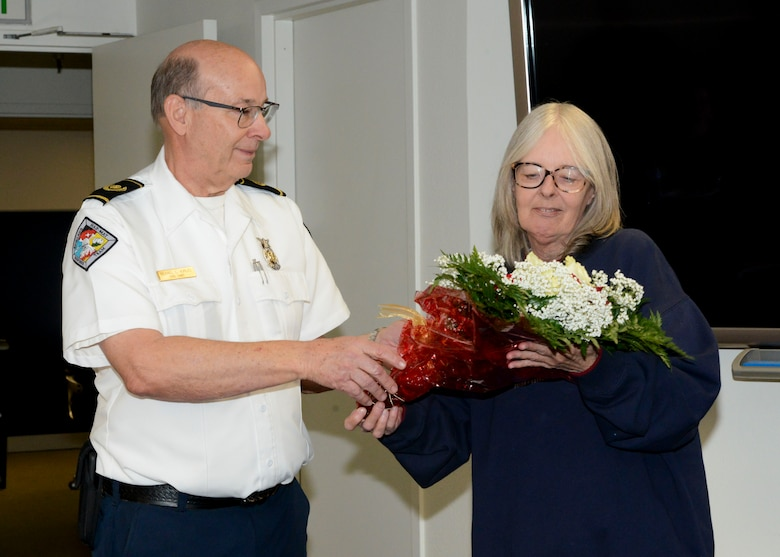 Retiring Fire Chief, Michael Hurles, presents flowers to his wife, Tammy, thanking her for her support during his retirement ceremony at Edwards Air Force Base, California, Dec. 14. Hurles retired after 42 years of service. (U.S. Air Force photo by Giancarlo Casem)
