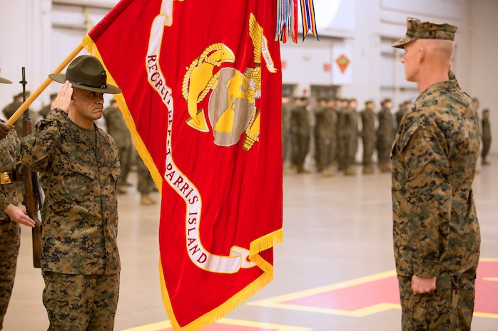 Sergeant Maj. Raphael Rodriguez relinquished duties as sergeant major of Marine Corps Recruit Depot Parris Island to Sergeant Maj. William Carter during a relief and appointment ceremony at the All Weather Training Facility aboard the depot, Dec. 14. (Official Marine Corps photo by Lance Cpl. Carlin Warren/Released)