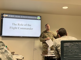 Lt. Col. Zack Hall, 15th Operations Support Squadron commander, addresses one of the Air Force's first ever Flight Commander Leadership Courses held Dec. 11-13 at Joint Base Pearl Harbor-Hickam. Hall, who served as the class mentor, assisted 13 company grade officers grow their leadership skills and understand the resources around base to better serve the Air Force. The course is designed to fulfill the Chief of Staff of the Air Force's vision to revitalize squadrons, by starting with flight leadership. (U.S. Air Force photo by 2nd Lt. Amber R. Kelly-Herard)