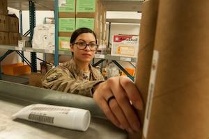 Senior Airman Erica Garcia, 379th Expeditionary Logistics Readiness Squadron hazardous material (HAZMAT) pharmacy technician, conducts inventory at the HAZMAT pharmacy Dec. 13, 2018, at Al Udeid Air Base, Qatar.