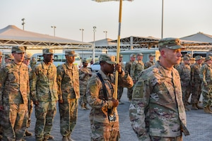 Army LTC Michael R. Rodick, 1st Battalion, 43rd Artillery Regiment Commander, leads his soldiers in formation during a monthly retreat ceremony at Al Dhafra Air Base, United Arab Emirates, Dec. 7, 2018.