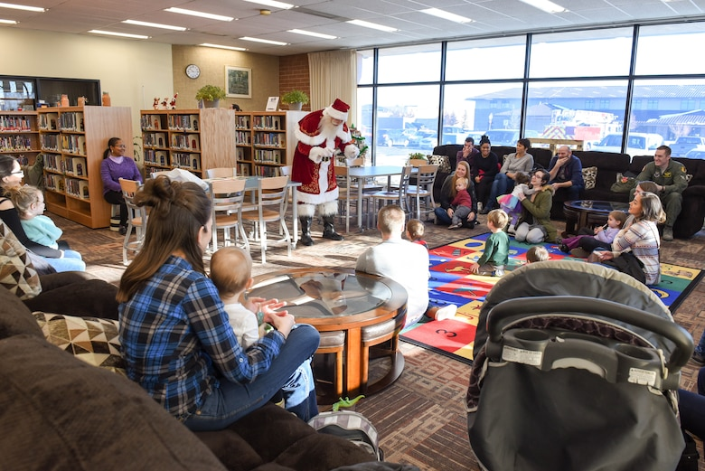 Santa Claus speaks to children at the Holbrook Library on Ellsworth Air Force Base, S.D., Dec. 13, 2018. Just 12 days prior his adventures on Christmas Eve, Santa took the time to spread holiday cheer with the children of Ellsworth AFB. (U.S. Air Force photo by Airman John Ennis)
