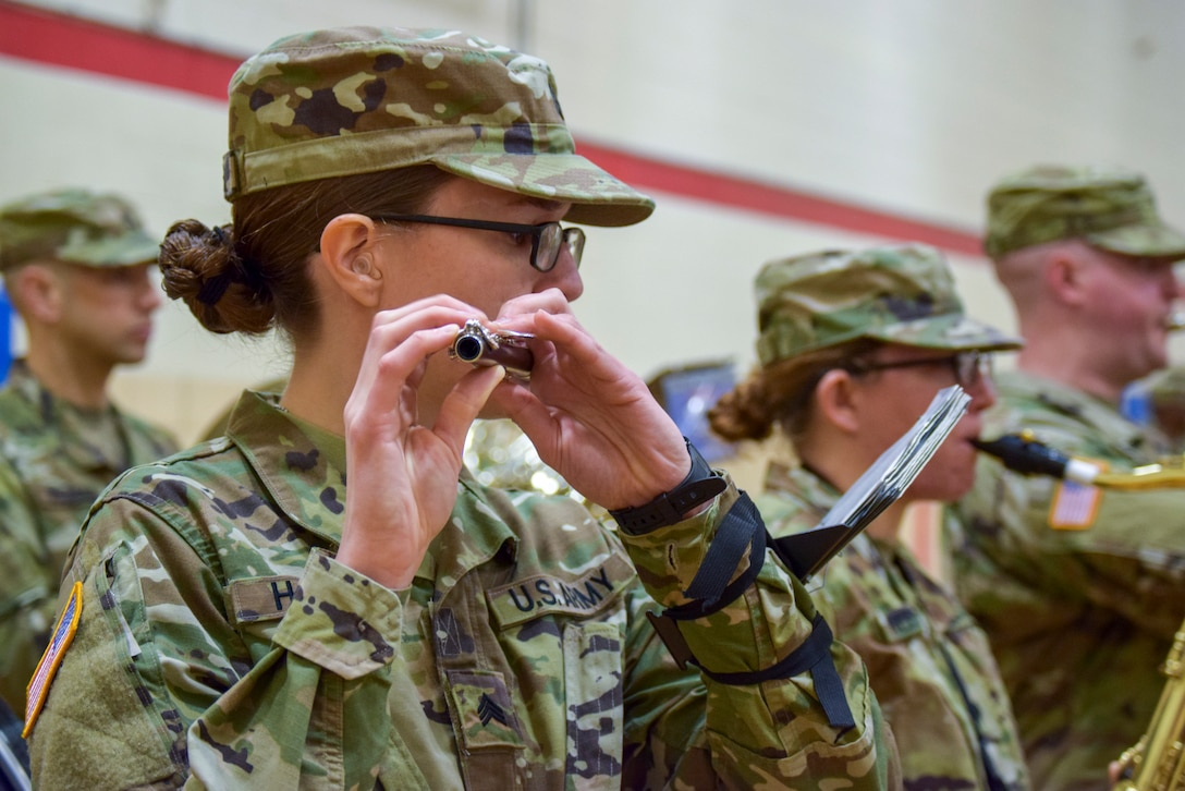 U.S. Army Reserve Sgt. Natalie Harper, a senior musician with the 78th Army Band, plays the piccolo, during the 99th Readiness Division change of command ceremony, Dec. 16 at Doughboy Gym, on Joint Base McGuire-Dix-Lakehurst, New Jersey. The 99th DIV(R) is headquartered on JBMDL, which is the second-largest employer in New Jersey, second only to the state government. More than 40,000 active-duty and reserve-component service members, civilian employees and family members work and reside on the base.