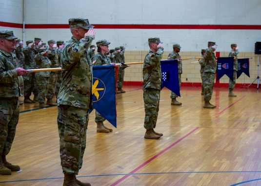 U.S. Army Reserve Soldiers salute during the 99th Readiness Division change of command ceremony, Dec. 16 at Doughboy Gym, on Joint Base McGuire-Dix-Lakehurst, New Jersey. The 99th DIV(R) is headquartered on JBMDL, which is the second-largest employer in New Jersey, second only to the state government. More than 40,000 active-duty and reserve-component service members, civilian employees and family members work and reside on the base.
