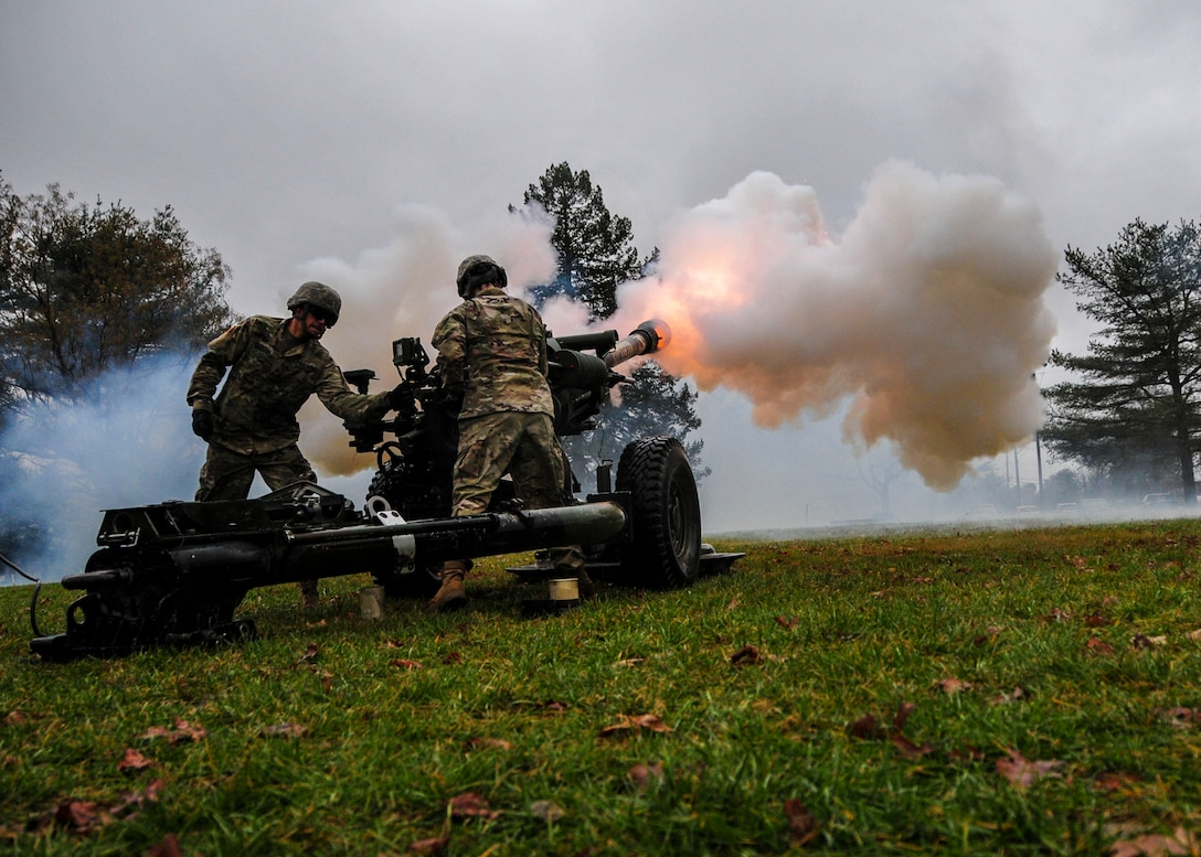 New Jersey Army National Guard 3-112th Field Artillery Regiment Soldiers fire ceremonial rounds for the U.S. Army Reserve 99th Readiness Division change of command ceremony, Dec. 16 at Doughboy Gym, on Joint Base McGuire-Dix-Lakehurst, New Jersey. The 99th DIV(R) is headquartered on JBMDL, which is the second-largest employer in New Jersey, second only to the state government. More than 40,000 active-duty and reserve-component service members, civilian employees and family members work and reside on the base.