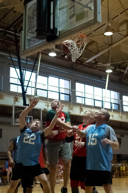 U.S. Air Force chief master sergeants and colonels from the 51st Fighter Wing play Basketball in the Chiefs Vs. Eagles game at Osan Air Base, Republic of Korea, Dec. 14, 2018.