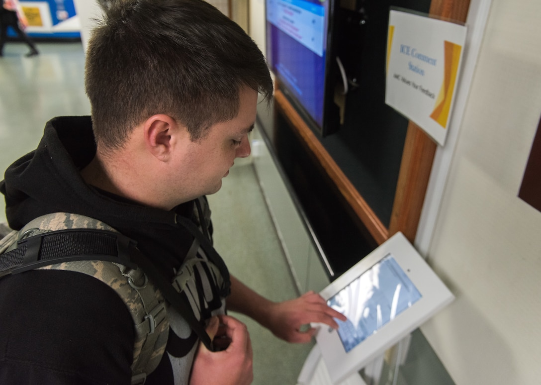Senior Airman Dylan Jesse-Tomlinson, 374th Logistics Readiness Squadron aircraft parts store technician, fills out an ICE comment survey