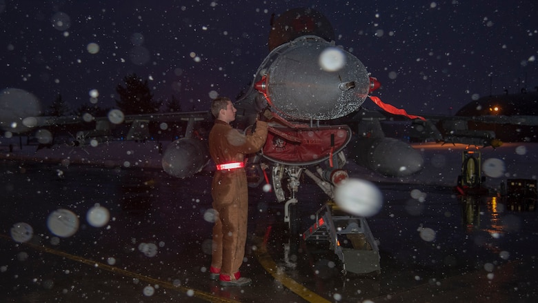 U.S. Air Force Airman 1st Class Avery Fortenbery, a 13th Aircraft Maintenance Unit crew chief, installs a pitot probe protective cover on an F-16 Fighting Falcon at Misawa Air Base, Japan, Dec. 11, 2018. Airmen ensure the mission goes on, no matter the weather. (U.S. Air Force photo by Airman 1st Class Genesis Tejada)