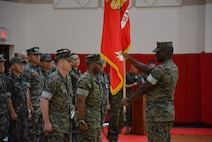 LtCol Horace J. Bly relinquishes command of Camp Mujuk to Col Sekou S. Karega.
