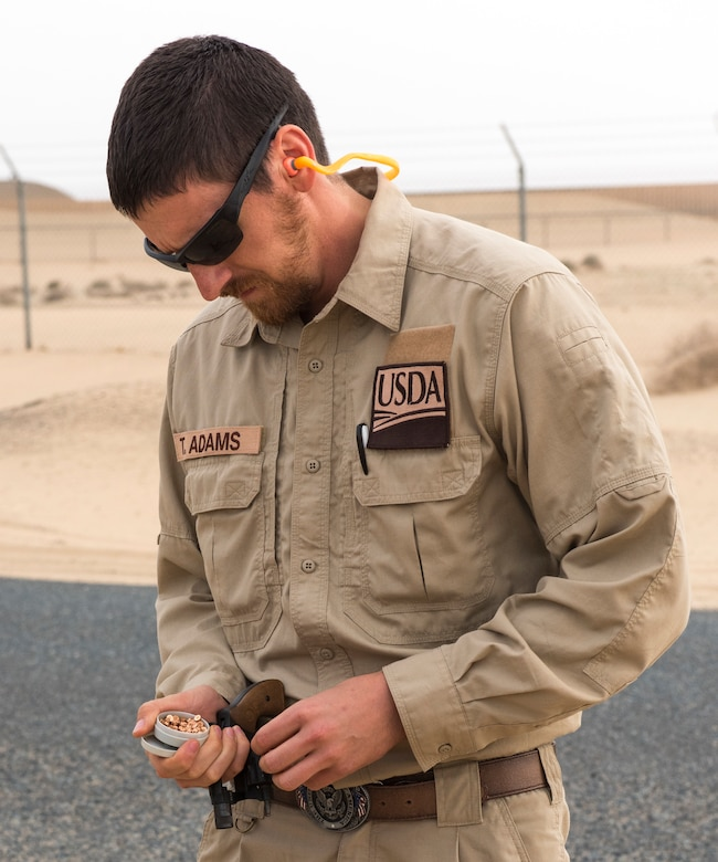 Tyler Adams, United States Department of Agriculture wildlife biologist, loads a revolver with pyrotecnic rounds, used to scare birds out of the area, at an undisclosed location in Southwest Asia, Dec. 3, 2018. During the first ever Bird/wildlife Aircraft Strike Hazard program, airfield managers were trained on not only pyrotecnics, but how to create a continuity binder with wildlife information from the area.
