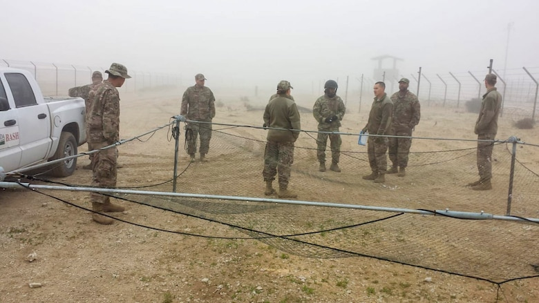 Airfield managers learn how to use a drop net to remove birds from the area at an undisclosed location in Southwest Asia, Dec. 4, 2018. Although the main focus of this training was to deter animals, training also heavily focused on building a continuity binder, where airfield managers can document animal sightings, food sources and water sources