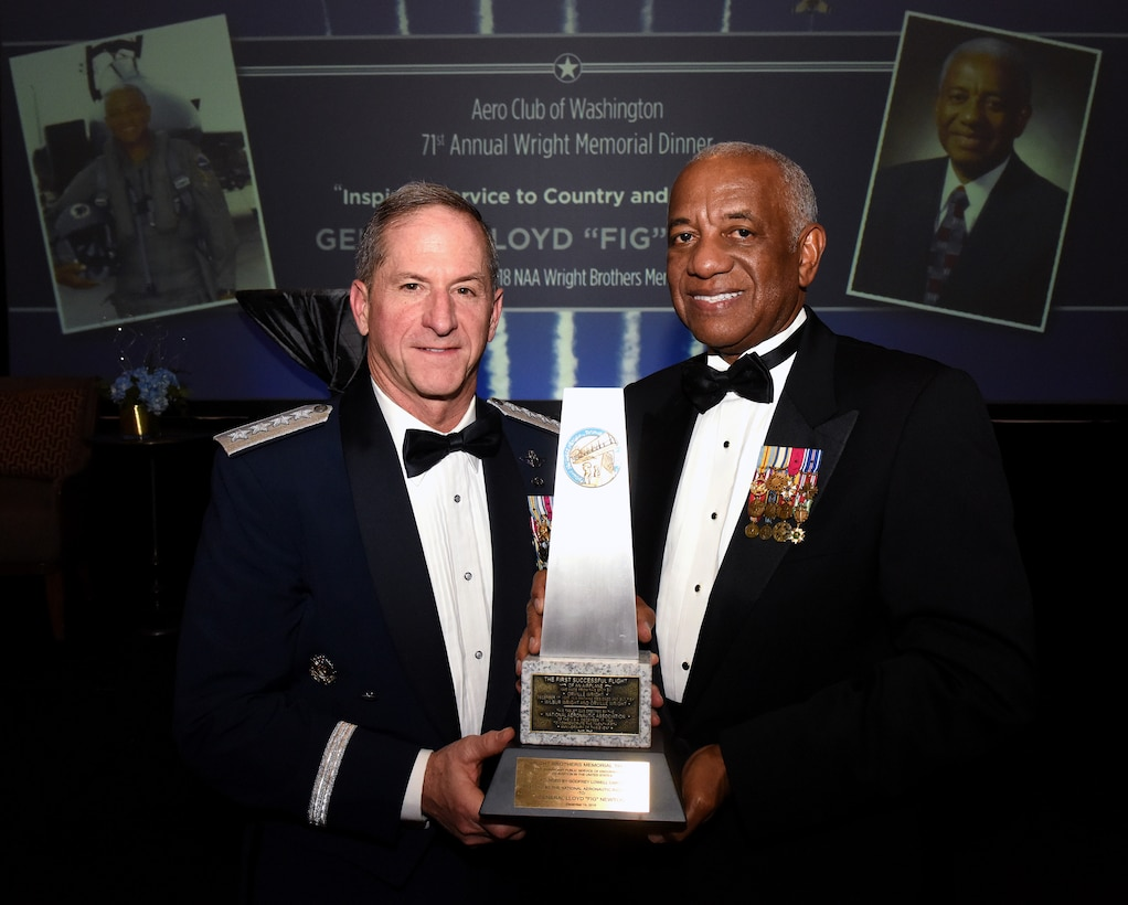 """Air Force Chief of Staff Gen. David L. Goldfein and retired Gen. Lloyd Newton, the 2018 Wright Brothers Memorial Trophy winner, pose for a photo after the 71st National Aeronautics Association Wright Brothers Memorial Dinner in Washington, D.C., Dec. 14, 2018. According to a NAA press release, the trophy was created in 1948 and is presented annually to a """"living American who has contributed significant public service of enduring value to aviation in the United States."""" (U.S. Air Force photo by Staff Sgt. Rusty Frank)"""
