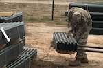 A soldier from the U.S. Army's 4th Infantry Division Sustainment Brigade unloads engineering stakes near the U.S./Mexico border, December 2018. Courtesy photo