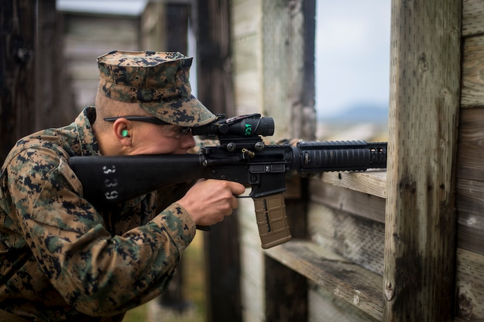 A U.S. Marine with 7th Communication Battalion, , III Marine Expeditionary Force Information Group, competes in the Far East Marksmanship Competition on Camp Hansen, Okinawa, Japan, Dec. 13, 2018.