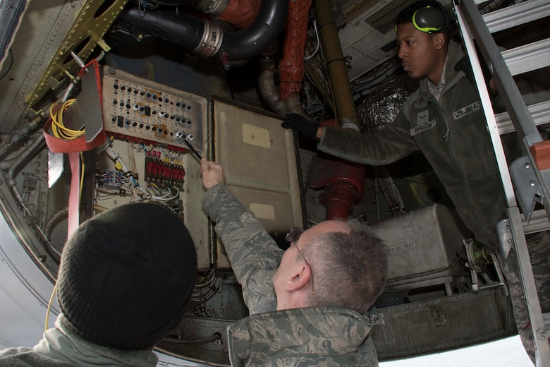 U.S. Air Force Master Sgt. Tim Pastore, 307th Aircraft Maintenance Squadron avionics specialist, reviews work done on a B-52 Stratofortress breaker box done by Senior Airman Deonitis Gardiner and Airman First Class James Johnson, 11th Aircraft Maintenance Unit journeymen, at Nellis Air Force Base, Nevada, Dec. 11, 2018.   Pastore is a Reserve Citizen Airman.  He regularly mentors active-duty Airmen like Gardiner and Johnson in keeping with the total force integration model. (U.S. Air Force photo by Master Sgt. Ted Daigle)