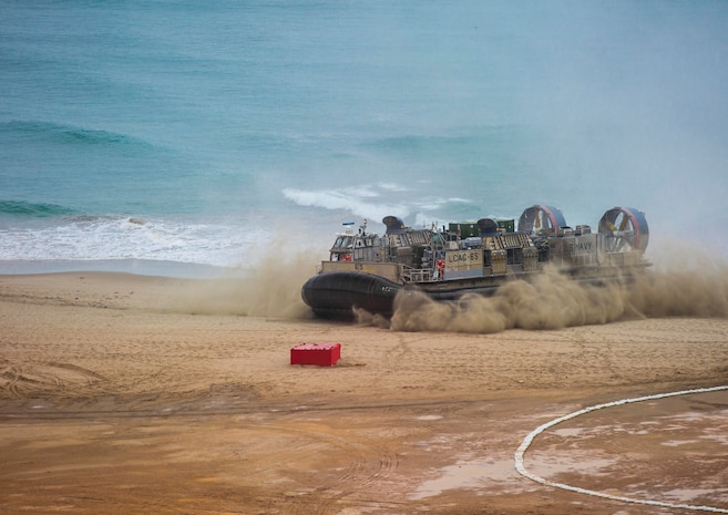 A U.S. Navy Landing Craft, Air Cushioned hovercraft carrying Marines and equipment from Special Purpose Marine Air-Ground Task Force - Peru arrives at the coastline during a humanitarian assistance and disaster relief demonstration between U.S. Marines and Peruvian naval forces Nov. 24, 2018, near Lima, Peru.