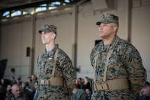 U.S. Marine Corps Capt. Samuel Mahaney (left) and WO Breeland Gloster (right) with Marine Attack Squadron 311 (VMA-311), Marine Corps Air Station (MCAS) Yuma, participate in the Change of Command Ceremony where Lt. Col. Michael W. McKenney, commanding officer for VMA-311 relinquished command to Lt. Col. Robb T. McDonald on MCAS Yuma, Ariz., Dec. 13, 2018. The Change of Command Ceremony represents the transfer of responsibility, authority, and accountability from the outgoing commanding officer to the incoming commanding officer. (U.S. Marine Corps photo by Sgt. Allison Lotz)