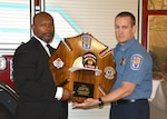 Assistant Fire Chief Fuller receives plaque at his retirement ceremony
