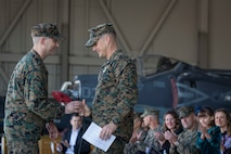 U.S. Marines with Marine Attack Squadron 311 (VMA-311), Marine Corps Air Station (MCAS) Yuma, participate in the Change of Command Ceremony where Lt. Col. Michael W. McKenney, commanding officer for VMA-311 relinquished command to Lt. Col. Robb T. McDonald on MCAS Yuma, Ariz., Dec. 13, 2018. The Change of Command Ceremony represents the transfer of responsibility, authority, and accountability from the outgoing commanding officer to the incoming commanding officer. (U.S. Marine Corps photo by Sgt. Allison Lotz)