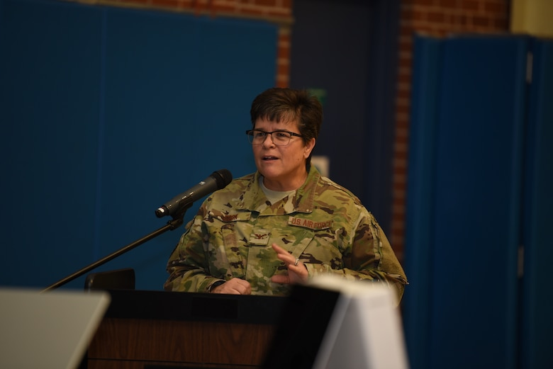 Col. Heather Cook, 319th Mission Support Group commander, congratulates the Torch Club members for their accomplishments, December 12, 2018, on Grand Forks Air Force Base, North Dakota. Cook said she wanted to let the Youth Center members know how proud she was of their hard work and effort to do their part to protect the environment. (U.S. Air Force photo by Airman 1st Class Melody Wolff)