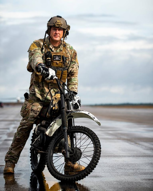 CAA Master Sgt. Joseph Kimbrell prepares to load a motorcycle onto a C-145A