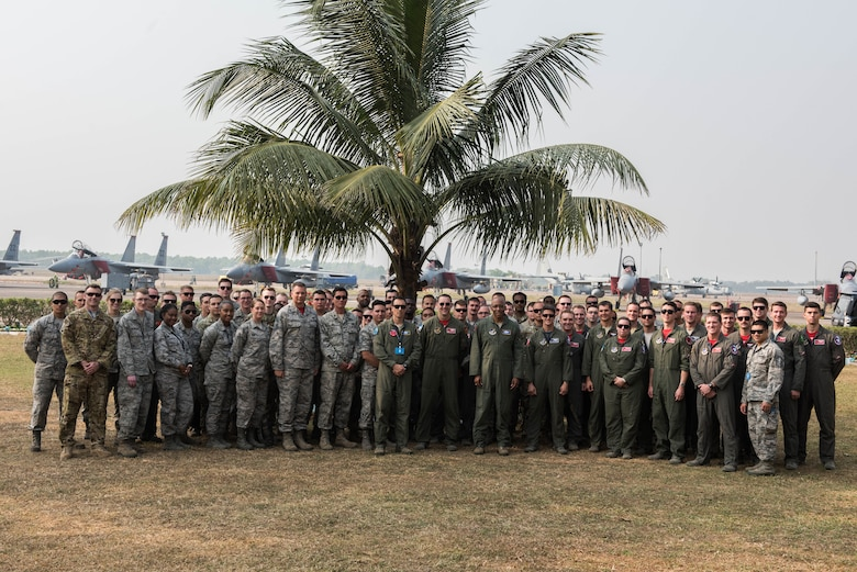 U.S. Air Force Gen. CQ Brown Jr., Pacific Air Forces commander, takes a group photo with Airmen from Kadena Air Base, Japan and the Illinois Air National Guard at Cope India 19 at Kalaikunda Air Force Station, India, Dec. 14,