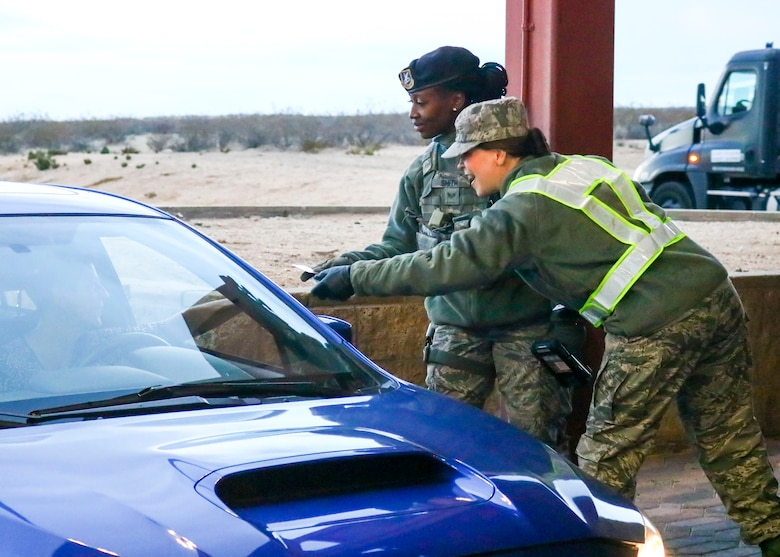 Lt. Col. Neva Vanderschaegen, 412th Medical Support Squadron commander, hands out candy canes to a Team Edwards member at Edwards Air Force Base, California, Dec. 17. (U.S. Air Force photo by Giancarlo Casem)