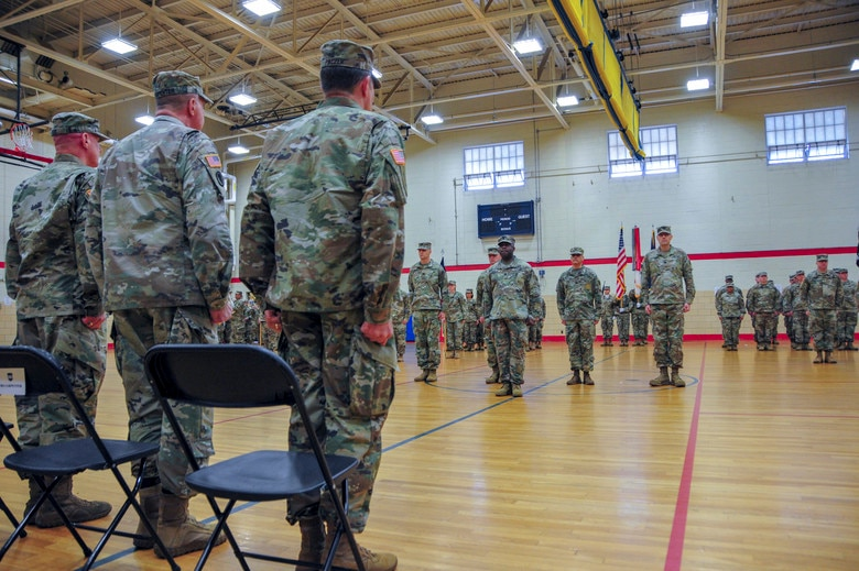 From right to left) Maj. Gen. Mark W. Palzer, the incoming commanding general,  Maj. Gen. Scottie Carpenter, the Deputy Commanding General of U.S. Army Reserve Command, and  Maj. Gen. Troy D. Kok, the outgoing commanding general stand at attention during the 99th Readiness Division change of command ceremony, Dec. 16 at Doughboy Gym, on Joint Base McGuire-Dix-Lakehurst, New Jersey. Both Kok and Palzer are New Jersey natives, the former having grown up in the Allentown area and the latter a current resident of Jackson.