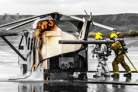 ARFF Marines practice putting out fires